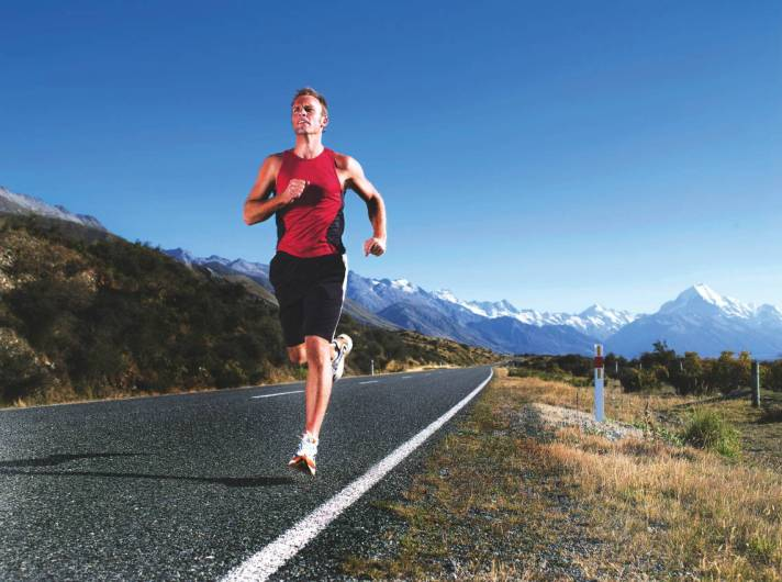 Man Jogging on Open Road