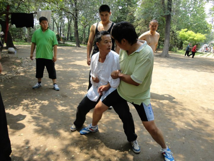 Zhou shifu, teaching Baji Quan to a group of Chinese students. All of them are bigger and heavier than him. The Chinese guy standing directly behind Zhou is Xiao Hei – a national Western-Boxing champion, who is 6'3 and weighs twice Zhou's weight.