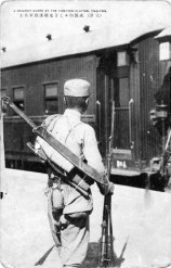 A Chinese soldier, carrying a Da Dao sword on is back, waiting at the Tianjin railroad