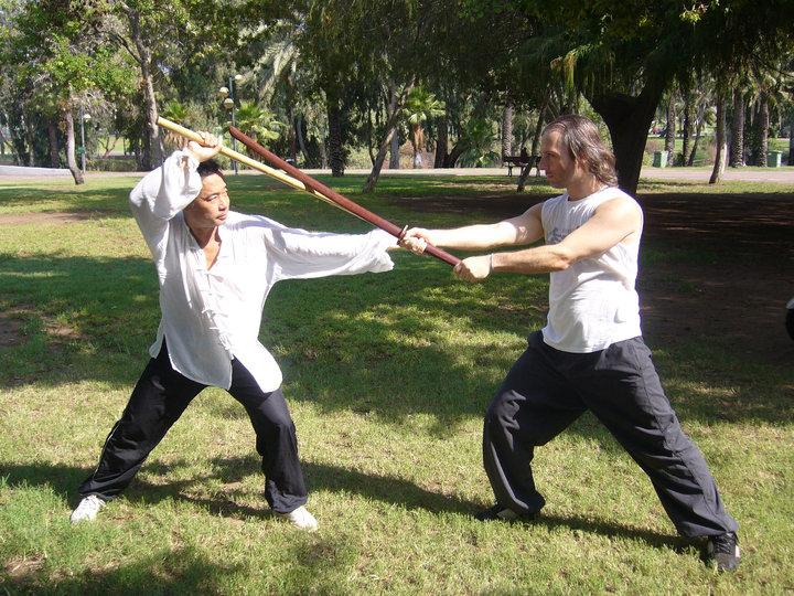 Zhou shifu teaching Ilan – a 3rd Dan Aikidoka from Israel.HaYarkon Park, Tel-Aviv, Israel, August 2010.