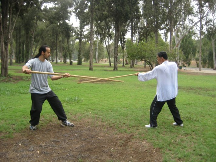 Zhou shifu, with one of his top students, Nitzan Oren from Israel. HaYarkon Park, Tel-Aviv, Israel, August 2010.