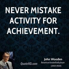 Never-mistake-activity-for-achievement.-John-Wooden-700x525